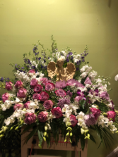 Angel sympathy Purple  Arrangement Funeral Flowers Roma Florist Free Delivery Order online