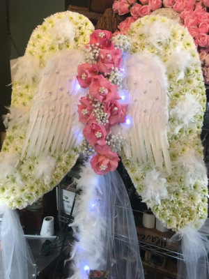 Angel wings  May the angels embrace you .... in Ozone Park, NY | Heavenly Florist