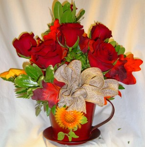 6 RED ROSES arranged in a cute TIN TEA CUP with fall trim and burlap bow! (TEA CUP COLOR MAY VARY)