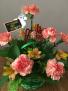 arachophbia basket arrangmentwith asst seasonal flowers