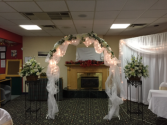 Archway & flower basket with stands Wedding rentals