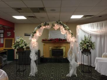 Archway & flower basket with stands Wedding rentals