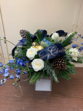 Artic Sky Centerpiece with fresh flowers and greens