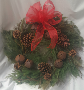 Artificial (Looks Real!) mixed Greens,pine cones,  rustic bells with bow. Would be a great gift for a door or centerpiece with a candle or lantern in center.