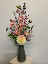 Artificial...not real Spring Has Sprung  Silk flower arrangement