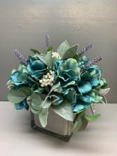 Artificial silk arrangement glass white cube Teal, white and lavender silk flower arrangement