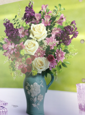 Artisanal beauty  Arrangement in blue ceramic water jug