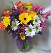 """SPRING FEVER"" MIXED SPRING FLOWERS ARRANGED IN A VASE WITH A BOW!"