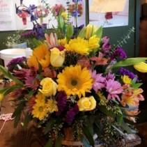 assorted garden basket done in seasonal flowers