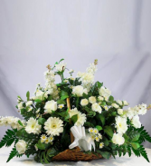 assorted white flowers in fire side basket