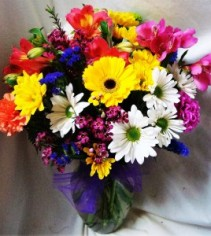 """Spring Seasonal flowers"" Mixed Spring seasonal  flowers arranged in a vase with a bow!"