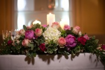 Sweetheart table with peonies and esperanza roses Reception