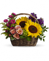 Basket Of Peach, Pink, Sunflowers, And Purple Summer Flowers