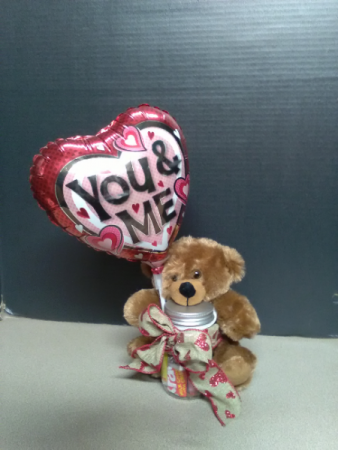 bear with candy and balloon gift