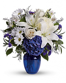 beautiful in blue vased arrangement