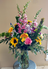 Beautiful mixed vase arrangement with assorted garden flowers in large cinch vase.