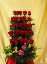 Beautiful stair arrangement  Red roses