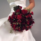 Beautifull Bouquet for a Christmas Wedding can be made smaller for your girls.