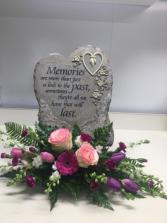 Bereavement  Memorial stone with fresh arrangement