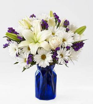 Beyond the blue vase in Claremont, NH   FLORAL DESIGNS BY LINDA PERRON