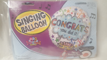 "NEW AND BECOMING VERY POPULAR !!  This is an oversized 28"" singing Congratulations Mylar balloon. Sings Celebration Song! (also available in birthday)"