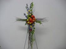 Birch Cross of Bells of Ireland, Delphinium, Roses, viking mums & Aster Shown at $115.00
