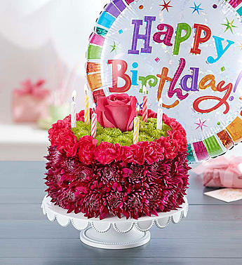 birthday flower cake flower arrangement and a birthday balloon in