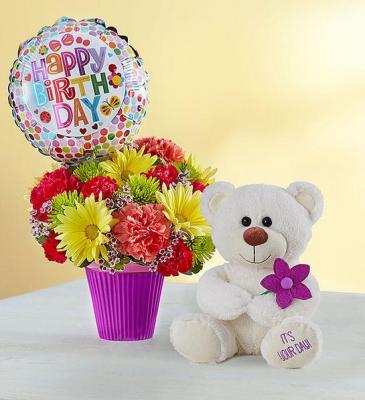 Birthday Fun Cupcake style container full of fresh flowers
