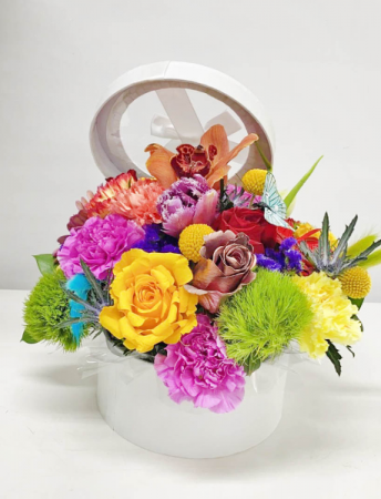 SPRING SURPRISE Flowers in Tall Circular Container