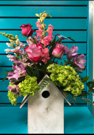 Blooming birdhouse planter