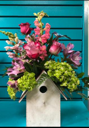 Blooming birdhouse planter