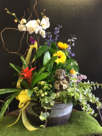 Blooming garden container with angel