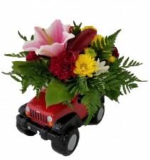 Blooming SUV Arrangement in Ceramic Container
