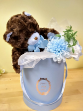 blue and brown bear with hand tied silk bouquet in keepsake hat box