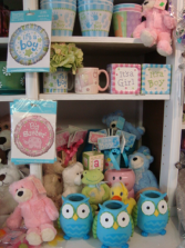 Blue and Pink owl containers to fill with flowers  for a Baby Boy or Girl! Select a price and we will arrange with blue and white or pink and white flowers.