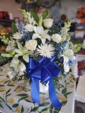 Blue and White Condolences Basket Spray