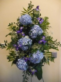 Blue Hydrangea Standing Spray with Iris, Babies Breath Shown at $100.00
