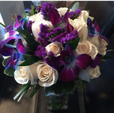 Blue Orchids and cream roses Wedding