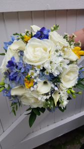 BLUE SKY PEAKING THROUGH CLOUDS Hand tied bouquet