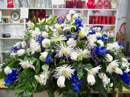Blue white casket spray in monroe nc monroe florist gifts blue white casket spray mightylinksfo Choice Image