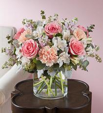Blushing Blooms Arrangement  All round arrangement