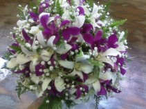 Bouquet done in purple and white orchids Brides Bouquet and can be made smaller for your girls
