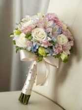 Bouquet with just a touch of soft blue For both a Bride and can be made smaller for your girls..prices vary due to size.