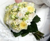 Bridal Bouquet Soft cream flowers , soft yellow , and a champange rose
