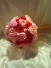 Bridal bouquet with pink peonies and red roses Bridal bouquet