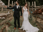 BRIDE AND GROOM CAPTURED by Photographer Chelle Wootten in this magical setting.