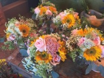 Bridesmaid's fun in the sun roses/sunflowers and wild filler flowers