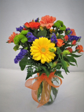BRIGHT AND BEAUTIFUL FRESH FLOWERS VASED