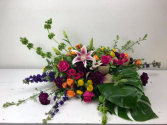Bright and Colorful Casket Arrangement