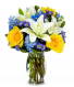 Bright Blue Skies Yellow roses, blue delphinium, white lilies